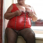 BBW wearing tight red PVC