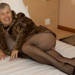Mature woman gets naughty in her hotel room