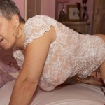 Mature woman playing with her vibrator