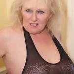 Sexy milf in black bodice